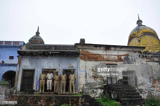 Police personnel stands guard at Ram Ghat Temple on August 27 2013 in Ayodhya India Security was on high alert in Ayodhya in wake of Vishwa Hindu...