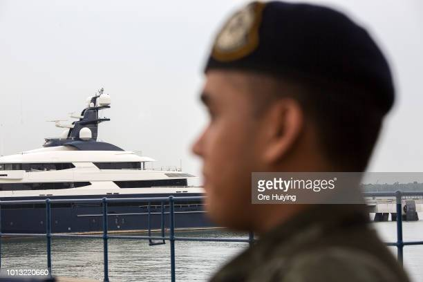 A police personnel stands guard over Equanimity the US $250 million luxury yacht that fugitive Malaysian businessman Low Taek Jho allegedly bought...