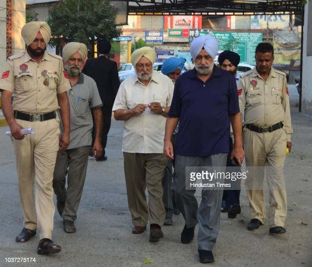 Police personnel take Chief Khalsa Diwan president Dr Santokh Singh to Central Jail Amritsar after he was sentenced to five year imprisonment and...