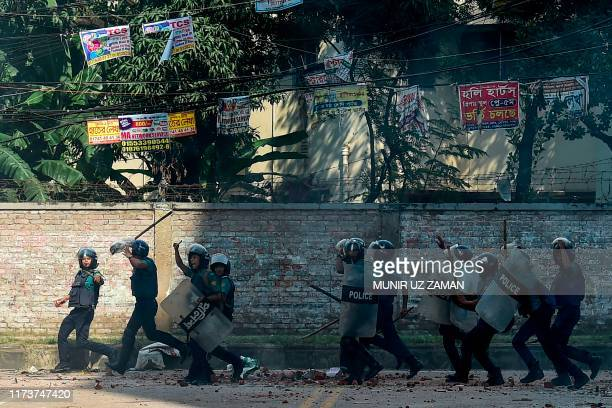 Police personnel try to disperse stranded Bihari residents during a clash with security forces at Geneva Camp in Dhaka on October 05 2019 Geneva Camp...