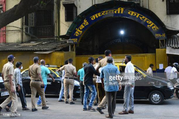 Police personnel walk past the entrance of the Arthur Road Jail, where Aryan Khan, son of Bollywood actor Shah Rukh Khan, is under custody after his...