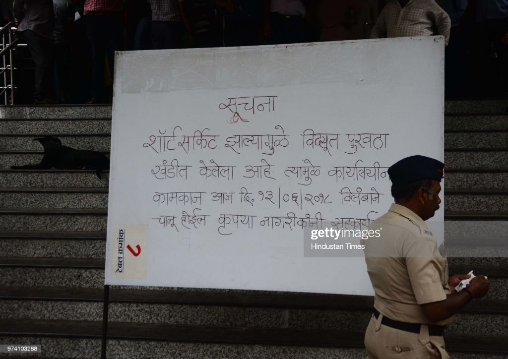 A police personnel walks past a message board at RTO after a fire breaks out, on June 13, 2018 in Pune, India. No one was injured in this incident and the situation was brought under control by the fire brigade within 15 minutes.