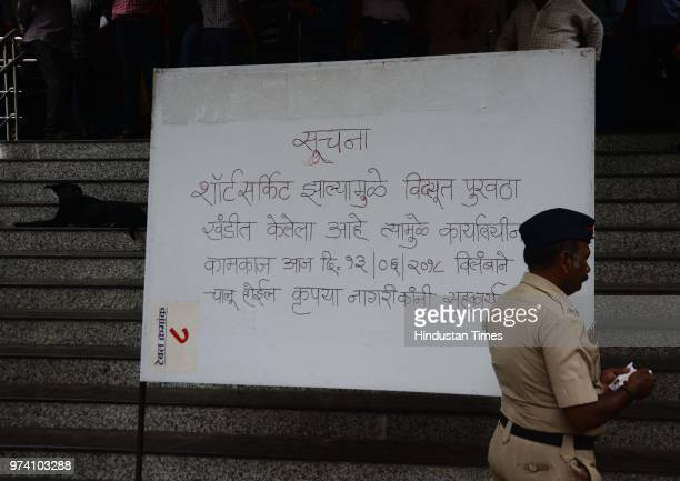 A police personnel walks past a message board at RTO after a fire breaks out on June 13 2018 in Pune India No one was injured in this incident and...
