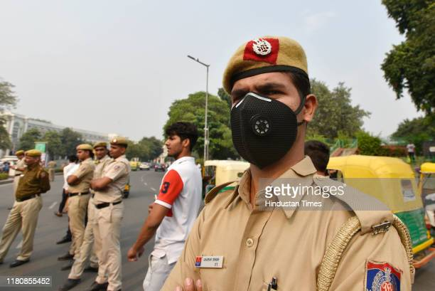 A police personnel wearing an anti pollution protective mask at Connaught Place on November 8 2019 in New Delhi India A layer of smog blankets the...