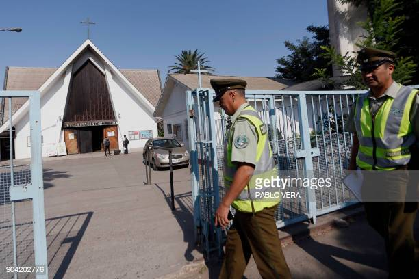 Police personnel work in the scene where an attack with an incendiary device occured and a threating message against the pontiff was placed at the...