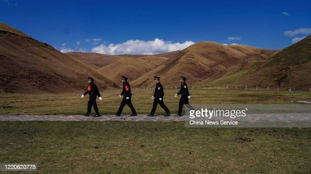 Police petrol at Dahai Grass Mountain on April 21, 2020 in Qujing, Yunnan Province of China. Officers of Dahai Town police station mark on 10,058...