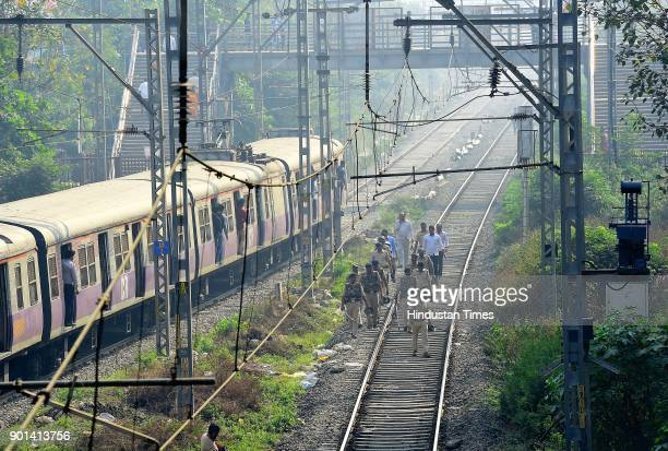 Police petroling on the railway track at Chembur Station during Maharashtra Bandh as Dalits protest and demand arrested of Sambhaji Bhide and Milind...