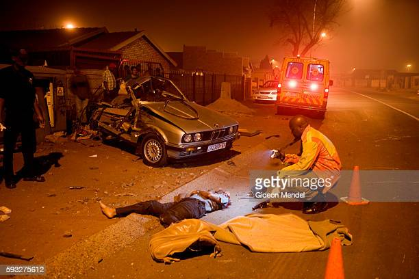 Police photographer documents the scene of a horrific car accident in Soweto. A driver had lost control of his vehicle and driven directly into the...