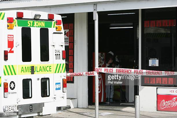 A police photographer records the scene at the Finlayson Superette in Clendon after an Auckland man was fatally stabbed in an attempted robbery...