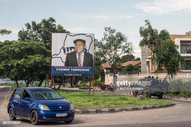 A police pickup patrol is seen outside the headquarters of the Union for Democracy and Social Progress party in Kinshasa on November 30 during a day...