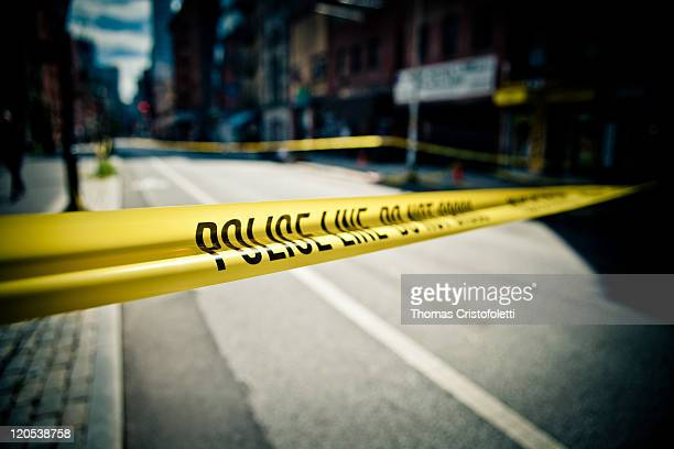 police - cordon tape stock pictures, royalty-free photos & images