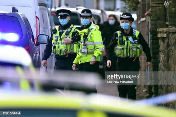 Police place a cordon around the scene of a multiple stabbing on March 5, 2021 in Treorchy, Wales. South Wales Police said they were dealing with a...