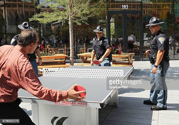 Police play a game of ping-pong near where groups are demonstrating near the site of the Republican National Convention on the last day of the...