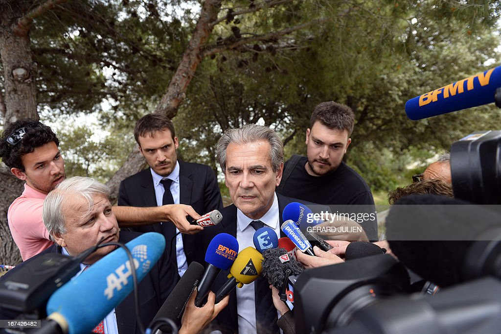 Police prefect of the Bouches-du-Rhone, Jean-Paul Bonnetain (C) answers the media near a crime scene where three persons have been killed and one injured during a shoutout earlier, on April 25, 2013 in Istres, near Marseille. A suspect has been arrested.