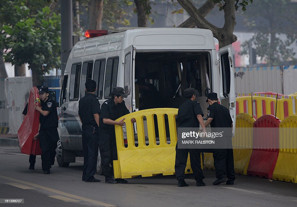 Police prepare barricades outside the Intermediate People's Court on the eve of the sentencing of disgraced politician Bo Xilai in Jinan, Shandong Province on September 21, 2013. The verdict in the case of China's fallen political star Bo Xilai, due on September 22, will cap an extraordinary scandal involving bribes, murder, illicit love, political infighting, and a colourful yet tightly controlled trial. Even before the stunning five-day hearing last month, the downfall of the once-powerful Bo was already the most sensational drama in decades to rock the ruling Communist Party and its prized stability. AFP PHOTO / Mark RALSTON