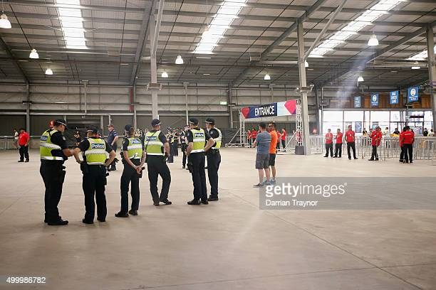 Police prepare for the the opening on the gates before entry into the Sterio Sonic music festival at Melbourne Showgrounds on December 5 2015 in...
