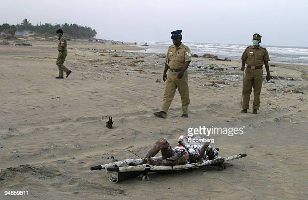 Police prepare to remove a body from the beach in Vailakanni India Wednesday December 29 2004 after a tsunami hit Southern India on Sunday As the...