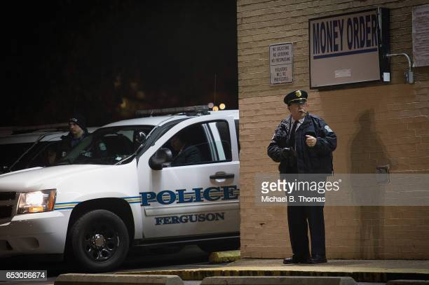Police presence is seen as demonstrators protests outside the Ferguson Market and Liquor on March 13 2017 in Ferguson Missouri Tension and protest in...