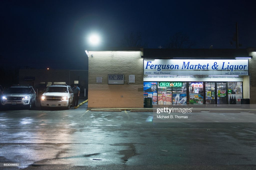 Police presence is seen as demonstrators protests outside the Ferguson Market and Liquor on March 13, 2017 in Ferguson, Missouri. Tension and protest in Ferguson has arisen in response to video footage of slain 18 year-old Michael Brown in a recent documentary.