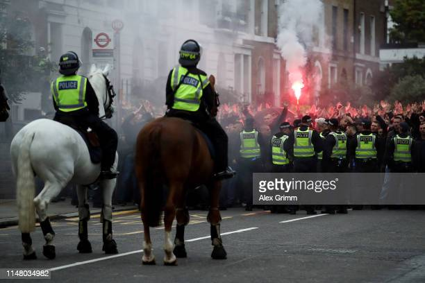Police presence is seen as fans let off a flare outside the stadium prior to the UEFA Europa League Semi Final Second Leg match between Chelsea and...