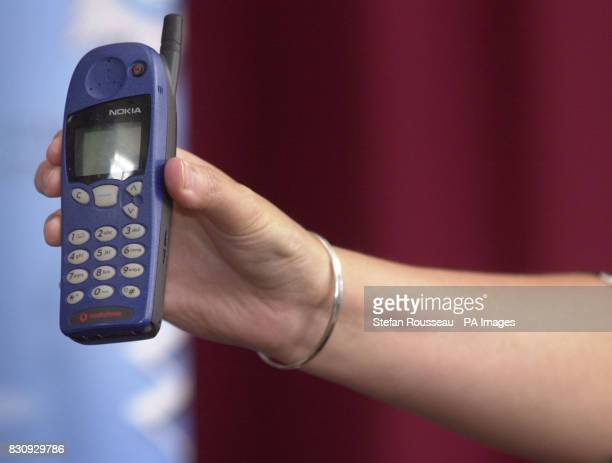 A police press officer holds up a Nokia mobile phone that is a replica of one owned by Jessica Chapman who is missing with her friend Holly Wells...