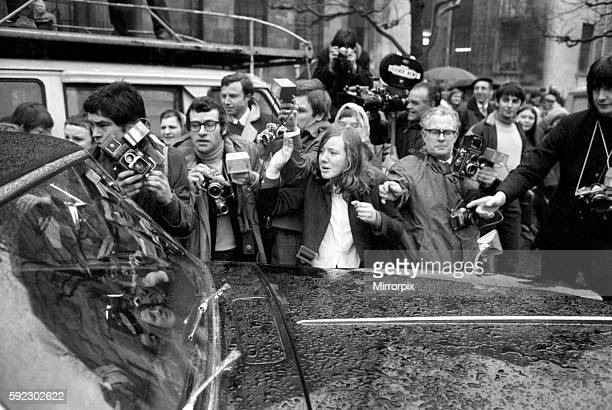 Police pressmen and fans surround the bridal couple's car as it leaves Marylebone register office March 1969 Z02419001