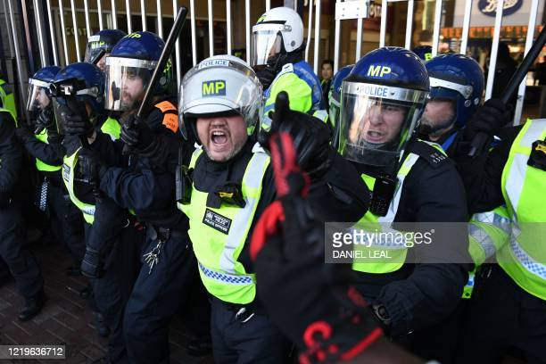 Police prevent people entering Waterloo Station after protesters supporting the Black Lives Matter movement clash with opponents in central London on...