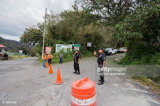 Police prevent the passage of people to La Yerbabuena community at La Becerrera community Colima State Mexico on October 2 due to teh actuivity of...
