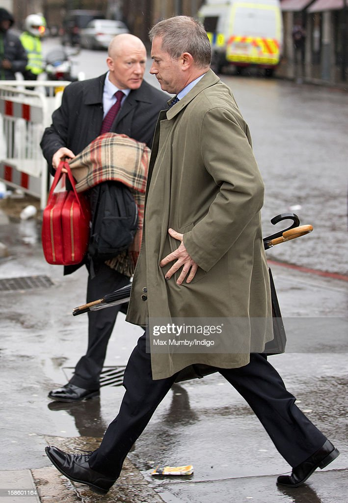 Police Protection Officers carry briefcases and blankets belonging to Queen Elizabeth II as she, accompanied by Prince Philip, Duke of Edinburgh, arrives at King's Cross Railway Station to take the train to King's Lynn on route to her Norfolk Estate, Sandringham House, for her traditional Christmas Break on December 20, 2012 in London, England.