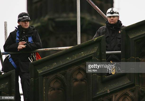 Police provide rooftop security during the wedding of Ed Van Cutsem and Lady Tamara Grosvenor at Chester Cathedral on November 6 2004 in Chester...