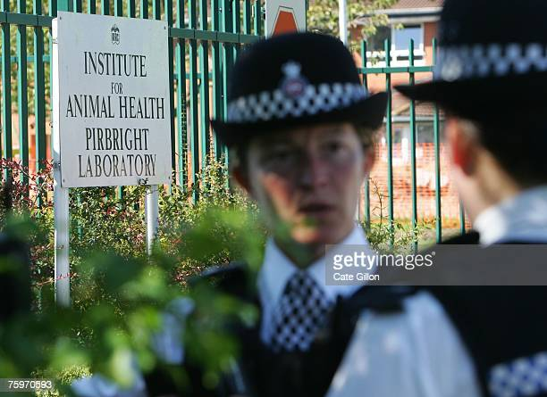 Police provide security outside the Institute for Animal Health Pirbright Laboratory on August 5 2007 in Pirbright England The outbreak of foot and...