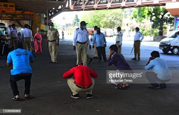 Police punishes people who fail to explain why they are roaming out during Nakabandi at Vakola signal, Santacruz during Lockdown due to Corona virus...
