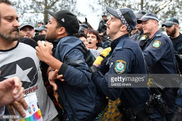 Police push away protesters before rightwing British provocateur Milo Yiannopoulos is set to speak to supporters in Sydney on December 5 2017...