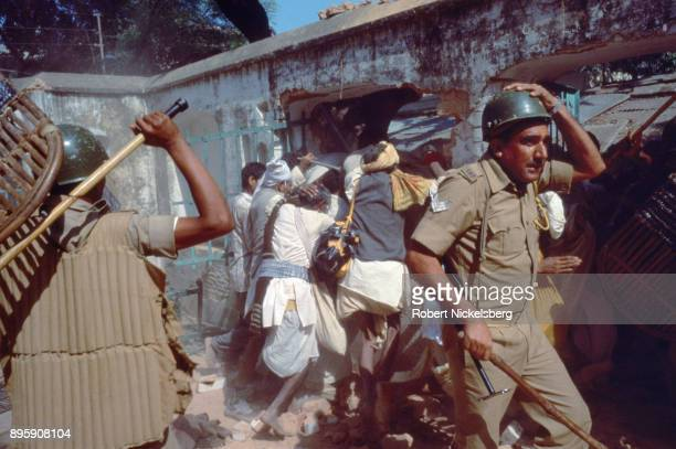 Police push back Hindu activists from entering into the Babri Mosque Ocotber 30 1990 in Ayodhya India The Hindu rightwing party Bharatiya Janata...