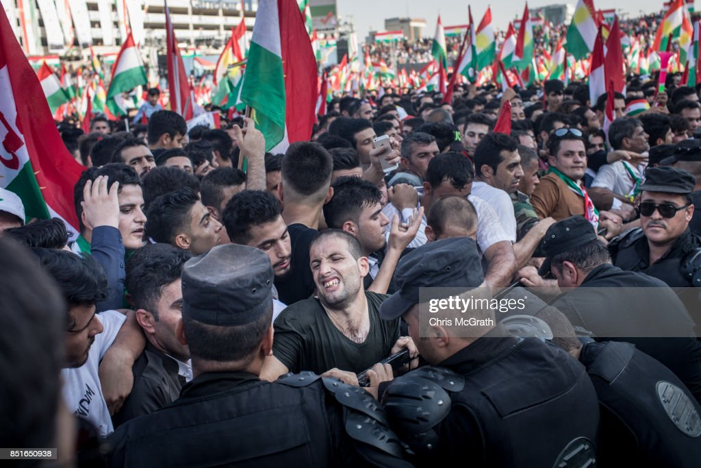 Police push back supporters awaiting the arrival of Kurdish President Masoud Barzani during a rally for the upcoming referendum for independence of Kurdistan on September 22, 2017 in Erbil, Iraq. The Kurdish Regional government is preparing to hold the September 25, independence referendum despite strong objection from neighboring countries and the Iraqi government, which voted Tuesday to reject Kurdistan's referendum and authorized the Prime Minister Haider al-Abadi to take measures against the vote. Despite the mounting pressures Kurdistan President Masoud Barzani continues to campaign and state his determination to go ahead with the vote.