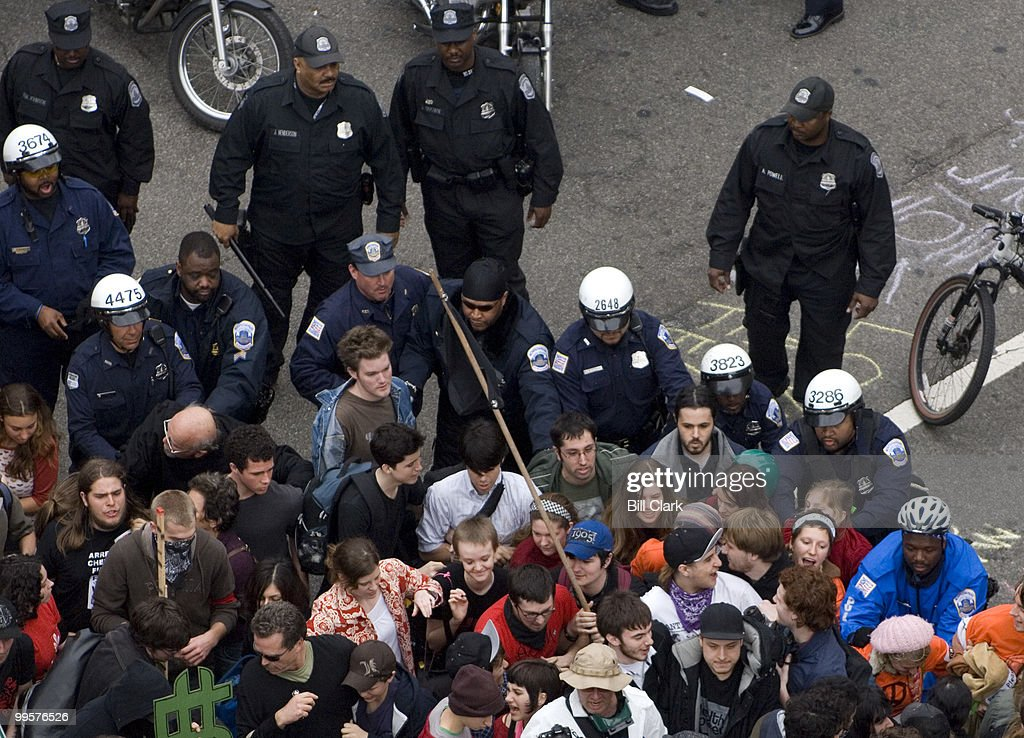 Police push Iraq War protesters out of the intersection of Vermont Ave. and L Street NW Wednesday afternoon, March, 19, 2008, the fifth anniversary of the start of the war.