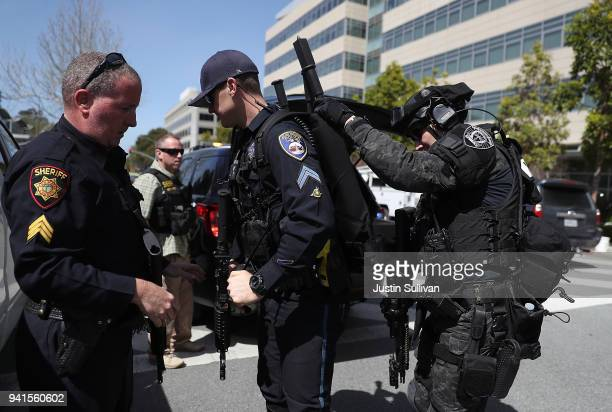 Police put on tactical gear outside of the YouTube headquarters on April 3 2018 in San Bruno California Police are investigating an active shooter...