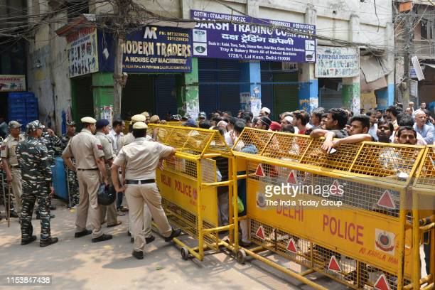 Police put up barricades in the Chawri Bazaar to prevent the communal tension from escalating in New Delhi