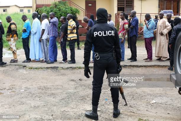 TOPSHOT Police question detained Muslim retail traders on December 17 2017 in Libreville following a knife attack on two Danish nationals Two Danish...