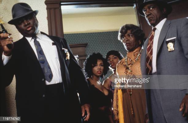 Police raid a brothel run by transvestite madam Big Kathy in a scene from 'A Rage in Harlem' directed by Bill Duke 1991