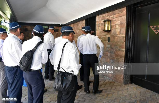 Police raid the home of Kunio Inoue chief of the crime syndicate Kobe Yamaguchigumi in Kobe western Japan on June 6 after he was arrested on...
