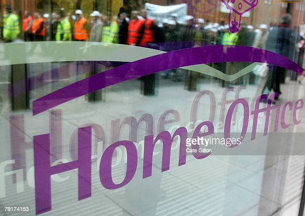A police rally is reflected in the window of the Home Office in central London on January 23 2008 Officers are demanding that a 25% pay rise be...