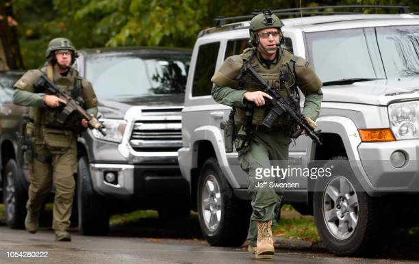 Police rapid response team members respond to the site of a mass shooting at the Tree of Life Synagogue in the Squirrel Hill neighborhood on October...