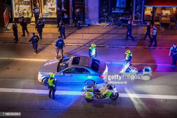 police razzia at nighttime - danish culture stock pictures, royalty-free photos & images