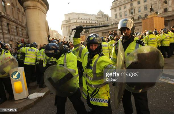 Police react to protesters near to thethe Bank of England as anti capitalist and climate change activists demonstrate in the City of London on April...