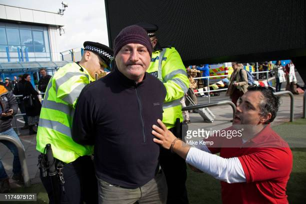 Police read section 14 notices and arrest protesters during Extinction Rebellion disruption outside City Airport on 10th October 2019 in London...