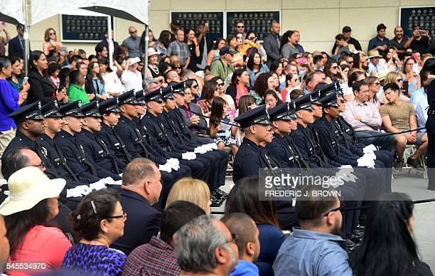 Police recruits attend their graduation ceremony at LAPD Headquarters where rappers Snoop Dogg and The Game led a peaceful demonstration outside on...