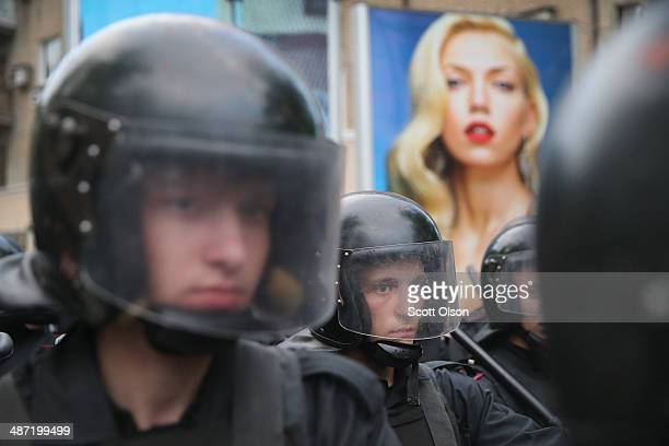 Police regroup after a clash of proRussian and progovernment activists during a rally and march on April 28 2014 in Donetsk Ukraine Several people...