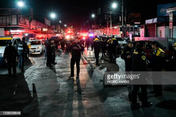Police remain at the entrance of Tacubaya metro station, where two trains collided causing the death of a passenger and 41 injured, in Mexico City on...