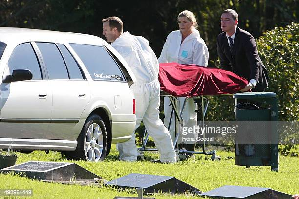 Police remove a body found at BirkenheadGlenfield cemetery on May 27 2014 in Auckland New Zealand Local police have found a body which they believe...